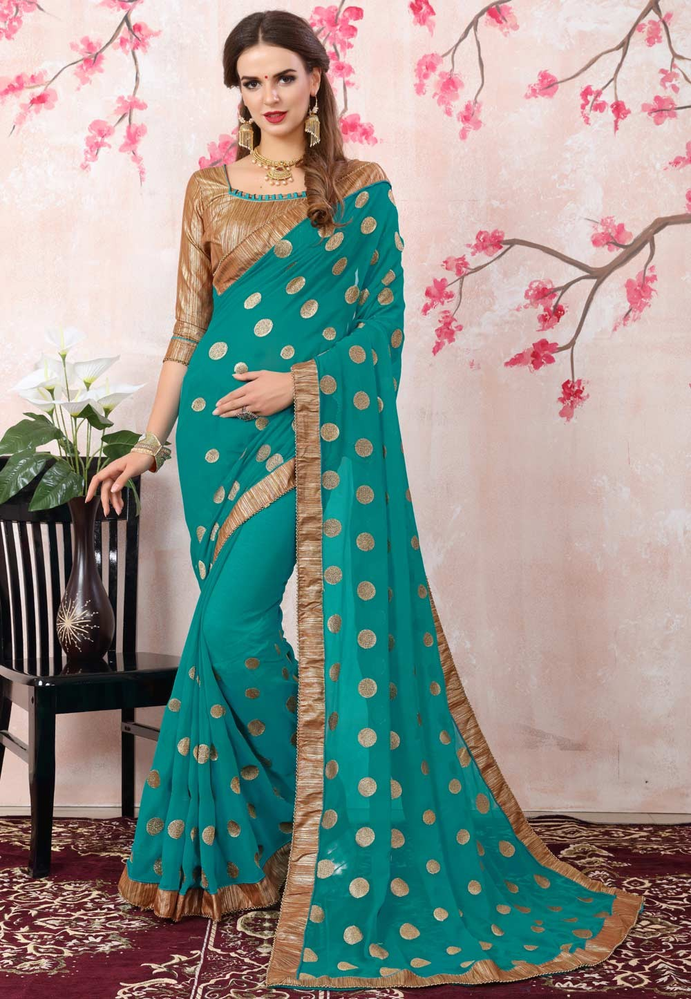 Attractive Looking Turquoise Color Georgette Ethnic Saree