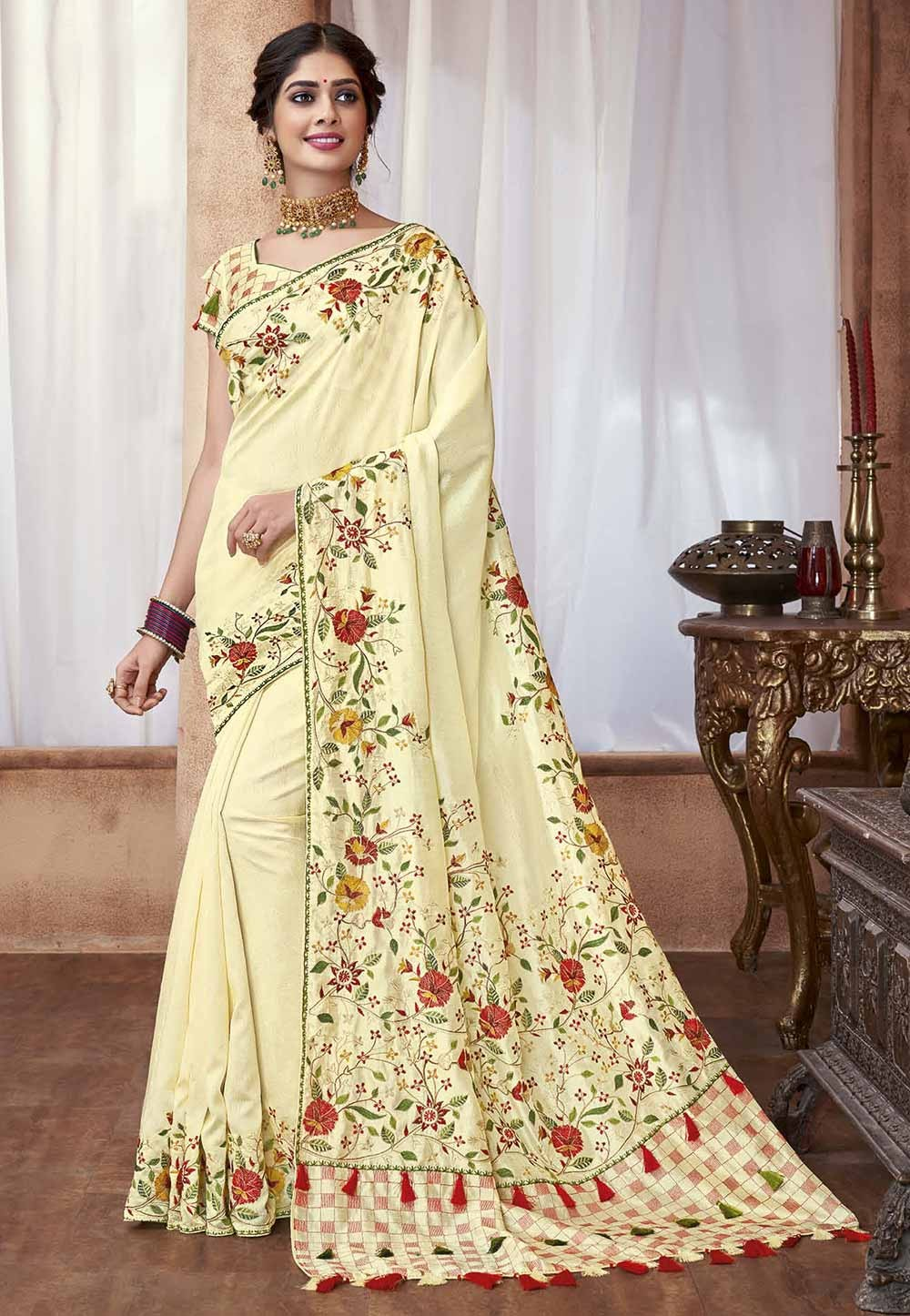 Cream Colour Embroidery Saree.