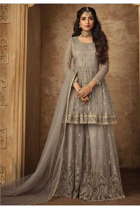 Grey Color Net Sharara Salwar Suit.