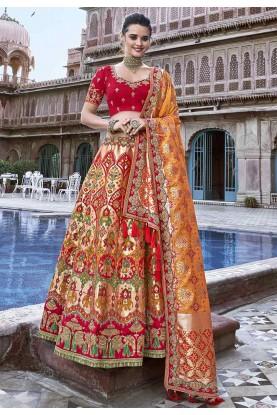 Orange Colour Silk Traditional Lehenga Choli.