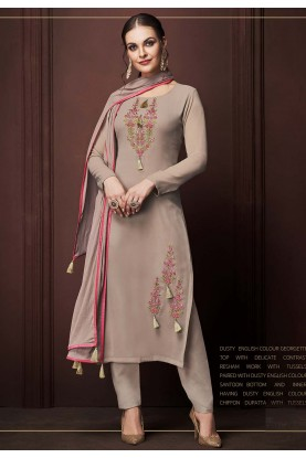 Rust Colour Georgette Salwar Kameez.