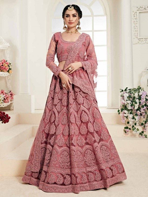 Classy Rust Colour Net Designer Lehenga Choli.