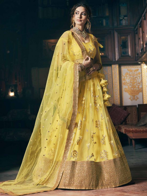 Net Fabric Wedding Lehenga Choli Yellow Colour.