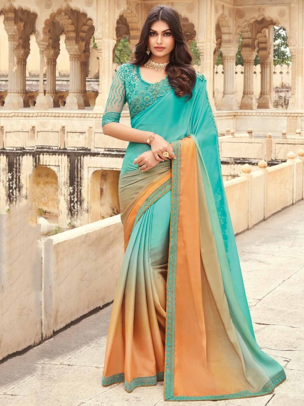 Turquoise Colour Silk Saree With Embroidery Work.