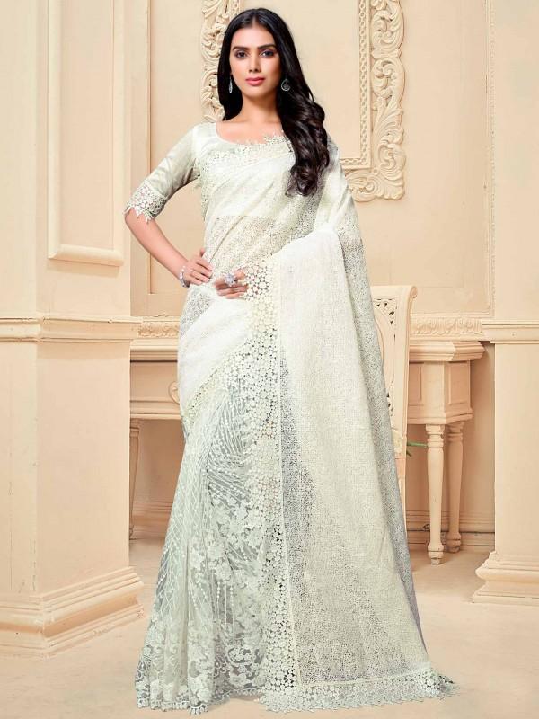 Cream Colour Fancy Saree For Women.