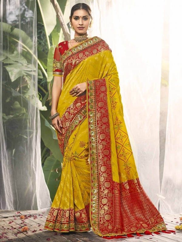 Yellow,Red in Silk Fabric With Embroidered Work Saree.
