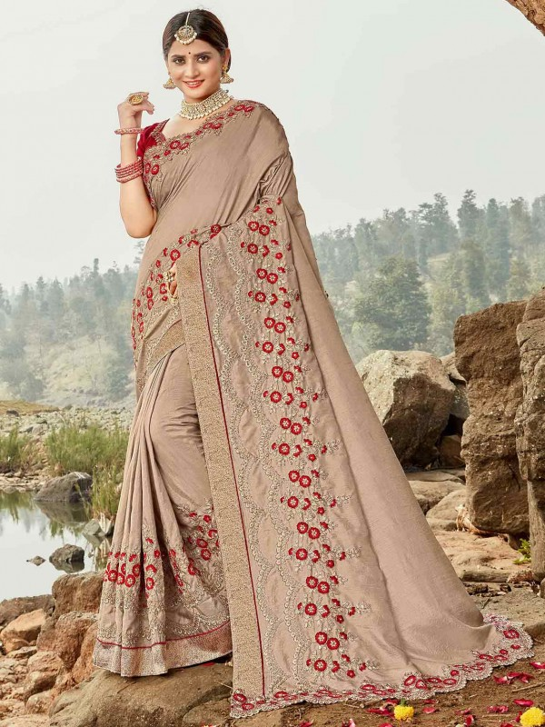 Beige Colour Embroidered Saree.