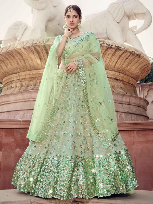 Pista Green Colour Net Wedding Lehenga.