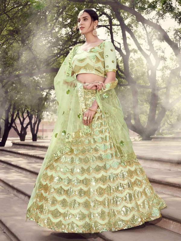 Pista Green Colour Net Designer Lehenga.