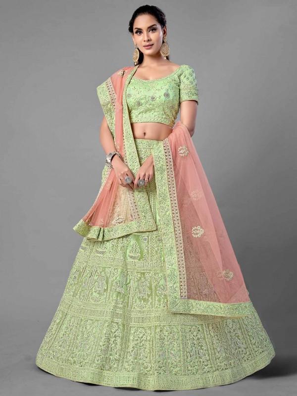 Pista Green Colour Net Fabric Engagement Lehenga Choli.