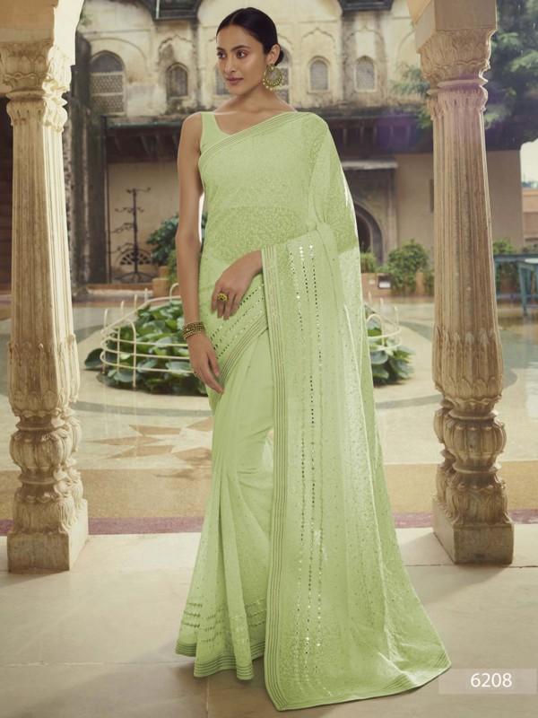 Green Colour Georgette Fabric Saree.