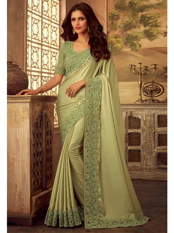 Pista Green Colour Silk Designer Sari.